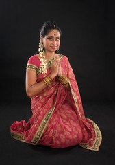 Indian girl in a greeting pose