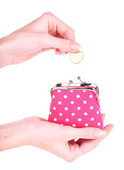 Female hand holding pink purse isolated on white