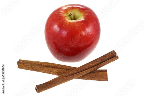 Cinnamon sticks and fresh Red Apple, isolated on white