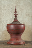Antique red lacquer wares in wooden crack background (Still life