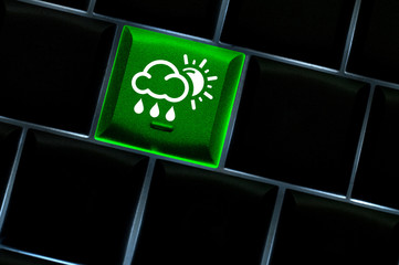Online weather Concept with back lit keyboard