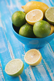 Fruits: limes and lemons, vertical shot