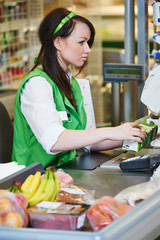 Shopping. Cashdesk worker in supermarket