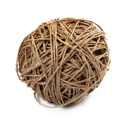 Closeup of a ball of hemp twine on a white background
