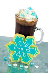 snowflake sugar cookie with beverage