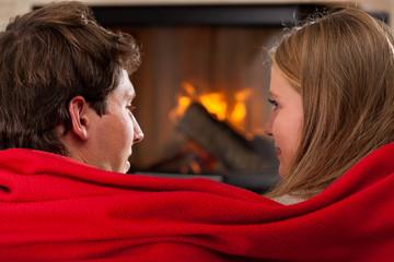 Under red blanket