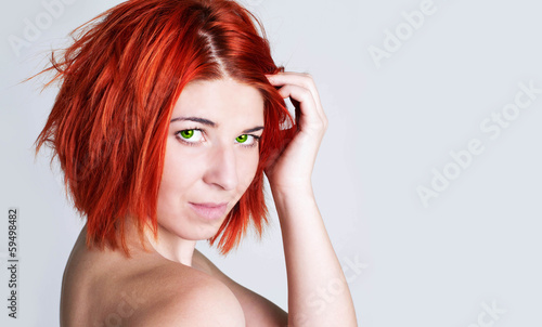 Fashion Model Woman.Red-haired beautiful girl