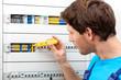 Repairman fixing a switchboard