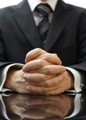 businessman with his hands clasped