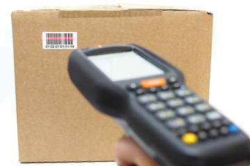 woman hold scanner and scans barcode with laser