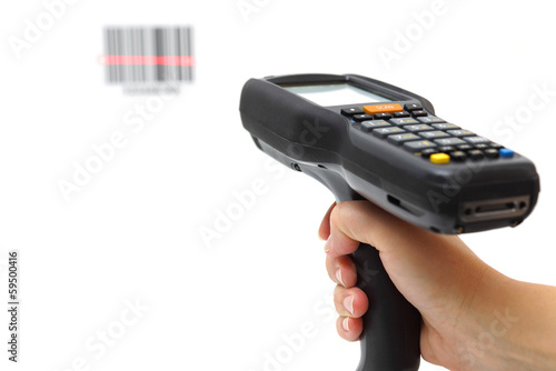 woman hold scanner and scans barcode with laser - 59500416