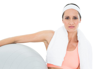 Portrait of a fit woman holding fitness ball
