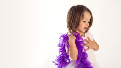 Young girl portrait with purple ostrich feather