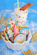 colorful gingerbread cookies and glass of milk for santa