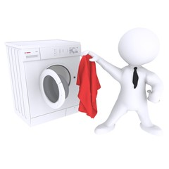 Man Holding Cloth In Front Of Washing Machine