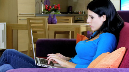 Woman working at home with computer