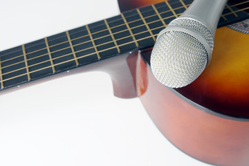 Microphone lying on a guitar
