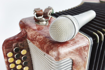 Microphone lying on a harmonica