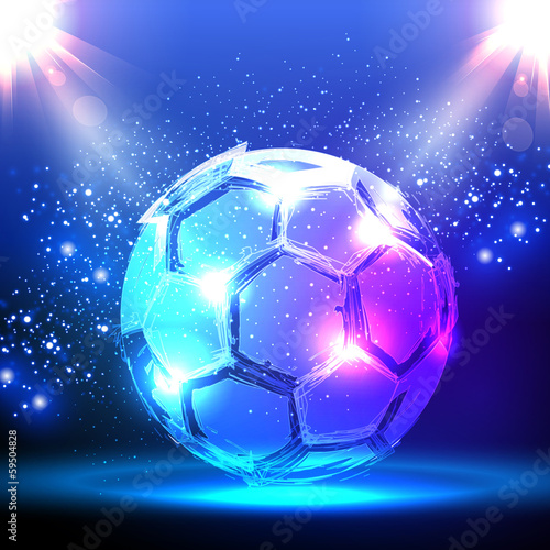 Soccer ball on blue spotlight