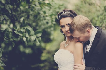 Bride and groom kissing outdoor