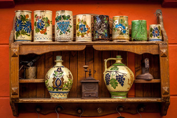 Various ceramic traditional pottery lined up for sale.