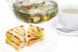 sandwich with tea on a white background in restaurant