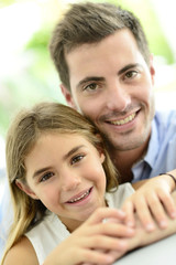 Portrait of cute little girl with her daddy