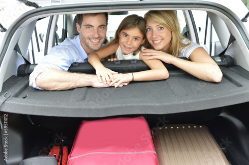 Cheerful family of three ready for vacation