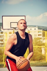 Basketball player concentrate and preparing for shoot