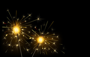 Sparklers burning on a black background