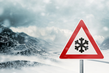 winter driving - snowfall - warning sign