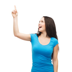 smiling teenager pointing her finger up