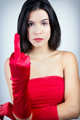 Sophisticated and angry woman with red dress