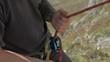 rock climbing detail shot of belay device