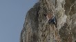 rock climber near top of cliff in Turzii Gorge, Transylvania,