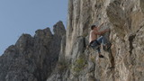 rock climber lunges for handhold climbing in Turzii Gorge