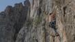 rock climber climbs behing corner in Turzii Gorge, Transylvania