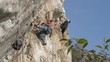 rock climber on limestone wall in Turzii Gorge, Transylvania,