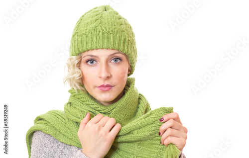 Female wearing warm sweater with wool scarf