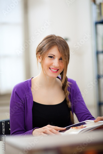 Smiing student in a library