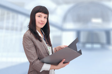 Businesswoman with document folder.