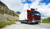 lorry with trailer driving mountain road