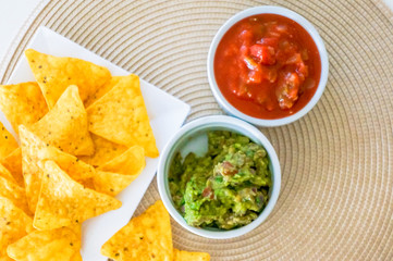 Mexican nachos. Homemade mexican salsas with corn chips