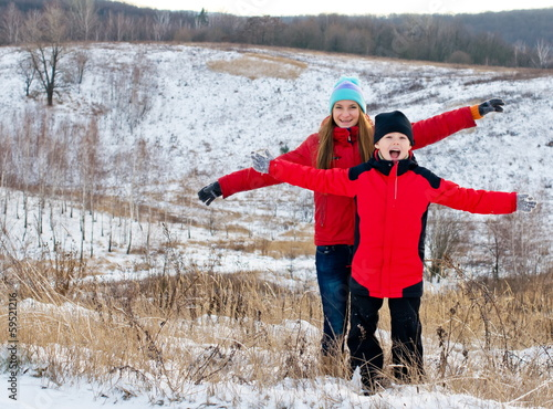 Happy children together outdoors in winter.