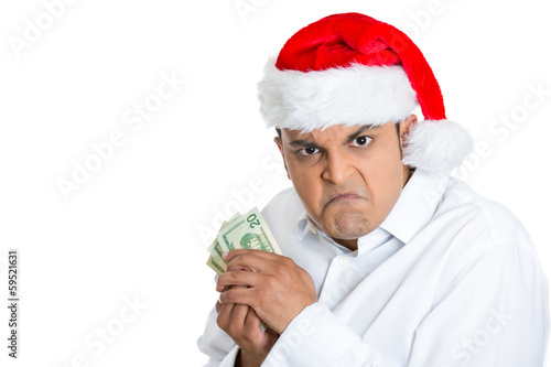 Greedy miserly christmas man possessive of his cash