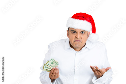 Miserly, greedy christmas man holding money, asking who cares