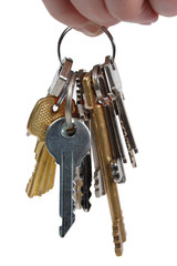 bunch of metal keys isolated on a white background. The human