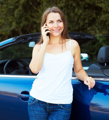Caucasian girl on a cell phone service or tow truck traffic near