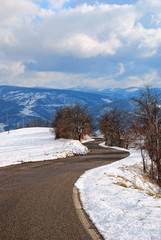 mountain road in winter with snow