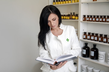 Pharmacist woman reading book